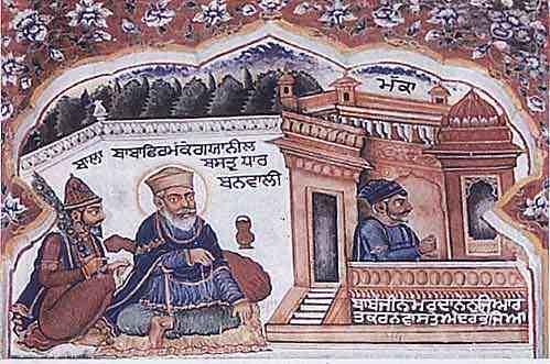 Sri Guru Nanak Dev Ji (centre) dressed in blue robes at Guruduara with Bhai Mardana (right) Ji and Bhai Bala Ji (left); Photo: Photographed by Sohan Singh Khalsaji/Wikimedia Commons