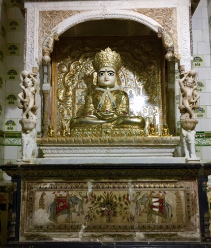 Fig. 1: Altarpiece of the deity of Neminathji made of white marble gilded with gold and silver plates at Shri Neminathji Temple, Azimganj, Murshidabad. (Courtesy: Mrinalini Sil)