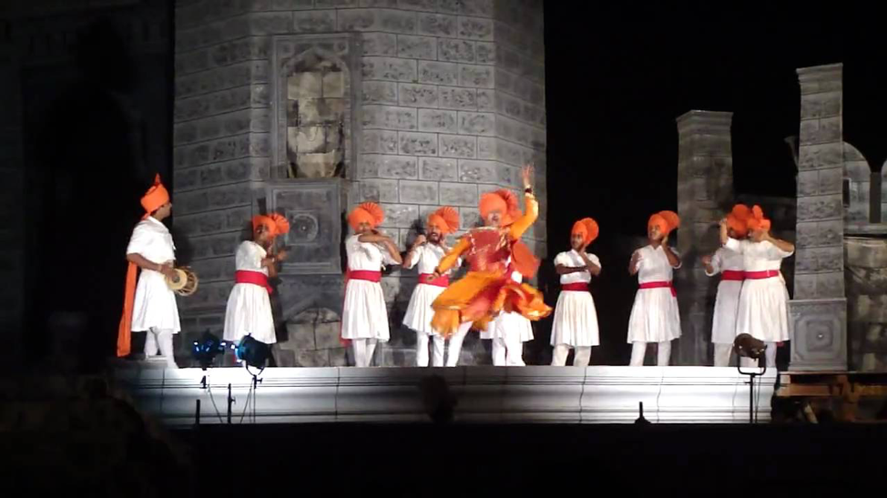 The shahir and his chorus group called 'phad' in a proscenium play Janata Raja (Courtesy: mrsush007's YouTube channel)