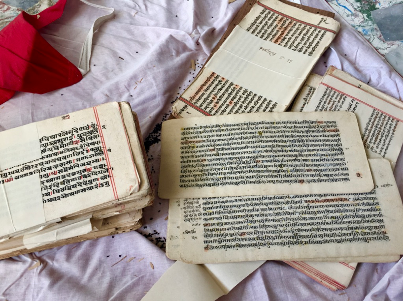 Fig 3: An open bundle of the textual handwritten manuscripts in  Shri Neminathji Bhandar Temple, Azimganj (Courtesy: Mrinalini Sil)