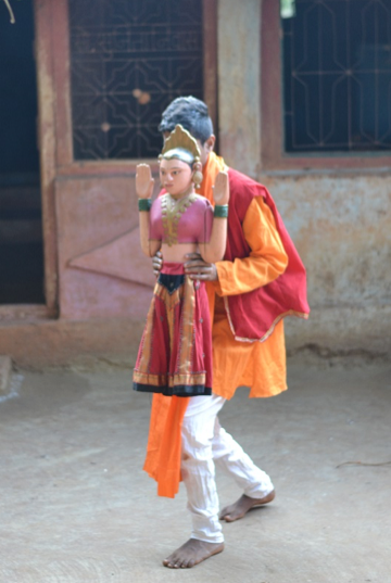 Figure 4: The Ranputali (dancing doll) in an original khele performance becomes navaryachi attu (groom's aunt) when the performance is a part of a wedding (Courtesy: Sonam Ambe).