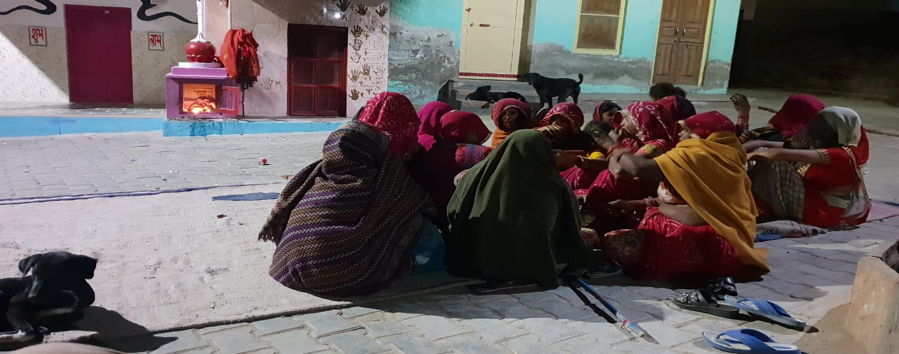 Fig. 4: Women congregate in a Meghwal mohalla for a ratijoga on the last day of Navratri in Ratangarh. Seen in the background is a shrine to Gogaji and an accompanying shrine to Mataji (Courtesy: Vishes Kothari)