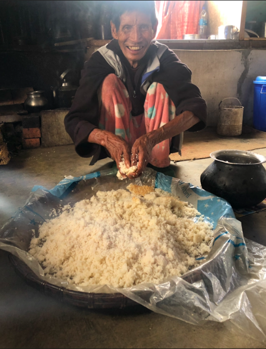 Fig. 1: A resident at a village in Tamenglong makes rice beer. He is mixing fermented rice cake with the rice. Rice was an integral part of the Ruangmei life and rice beer was akin to tea for the people. Rice beer was a drink for every occasion and songs were sung during the process of making it