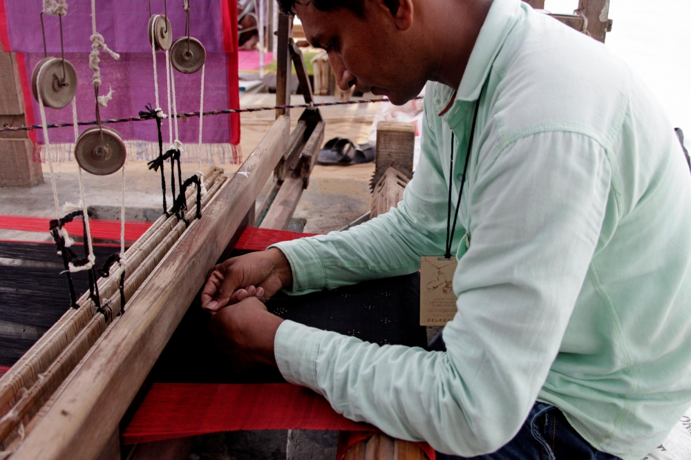 The weave of the thangaliya cloth is a simple plain weave. The dots are created using fine cotton threads. Motifs are woven into the fabric while still on the loom.