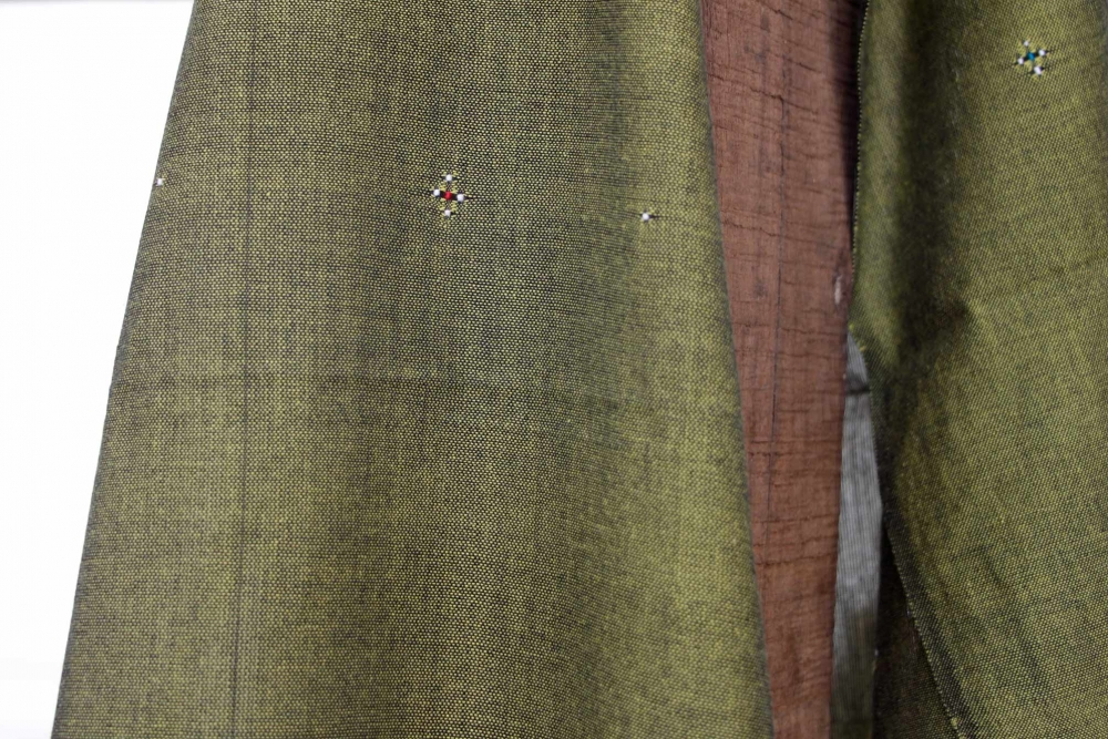 Each little dot is woven individually, and eventually a motif is transferred from the weaver's mind onto cloth, with no help of paper and pen.