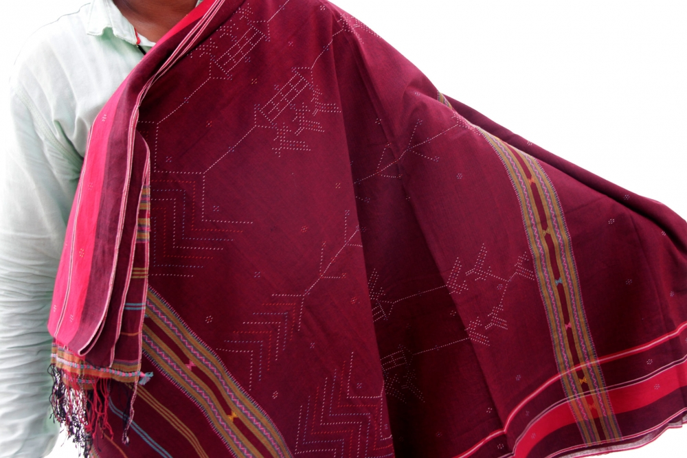 Suresh Vankar displays a detailed cotton saree woven by him.