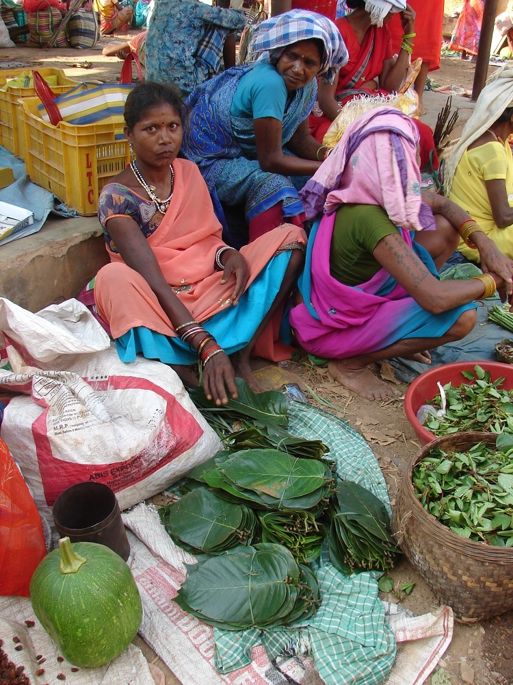Woman selling dona pattal in a local market