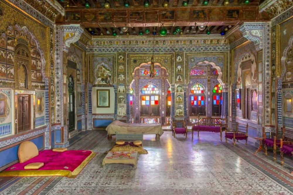 Fig. 4 Takhat Villas, bedroom of Maharaja Takhat Singhji. This room is decorated with paintings, stained glass and Christmas balls. Not just the walls and ceiling but the floor is also painted in this period room.