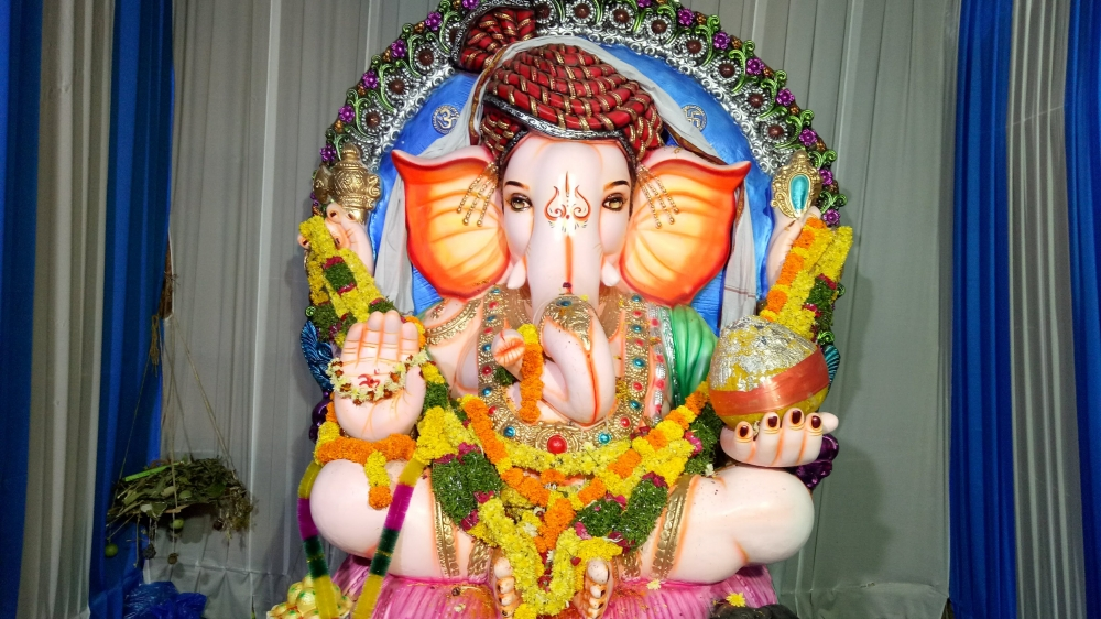 Ganesha with modaks in his hand, Couretsy: Wikimedia Commons