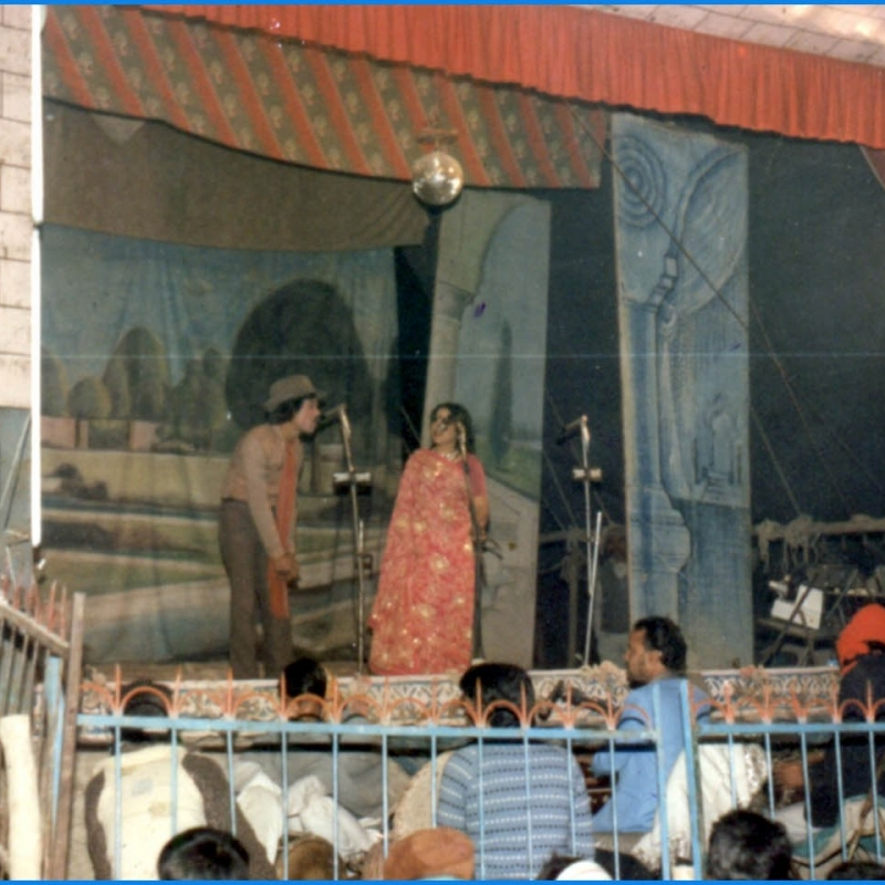 A typical nautanki performance scene from the 1950s–60s: musicians sit in an enclosure in front of the stage, there are elaborate drop curtains and painted sceneries, and actors wearing costume and make-up enact a play with dialogue and songs. (Photo courtesy: Deepti Priya Mehrotra)