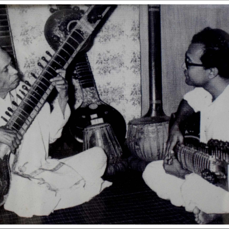 Legendary Bishnupur Gharana musician Gokul Nag (left) playing the sitar with his son Manilal Nag (right).