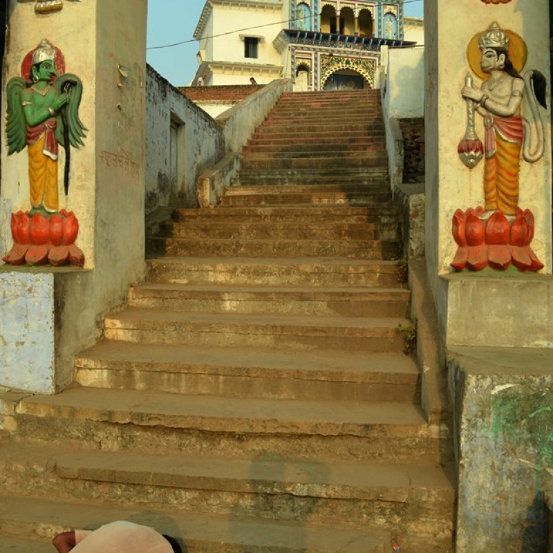 A devotee at the steps of a temple in Chitrakoot