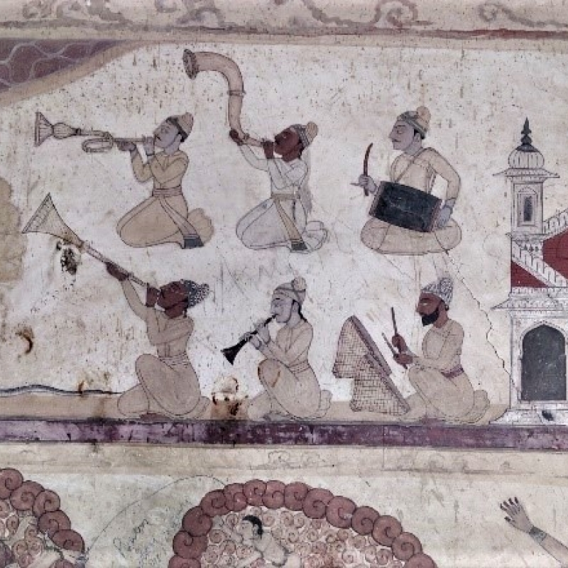 A mural in the Devi Kothi Temple in Chamba depicting a band of musicians. The mural is divided into various registers, with the musicians occupying the central one (Courtesy: Sarang Sharma)