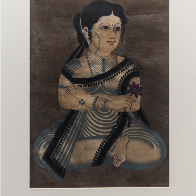 After migrating from rural areas to the urban Kali temple surroundings in Calcutta, the Kalighat patuas initially painted mythological characters. However, over time, their topics changed to include urban dwellings and secular themes: from the doings of babus and bibis to raging court cases of the time. This painting shows an urban woman sitting cross-legged, with a smile on her face, probably pondering over the day's events (Courtesy: Darshan Shah/Weavers Studio Research Centre, Kolkata)