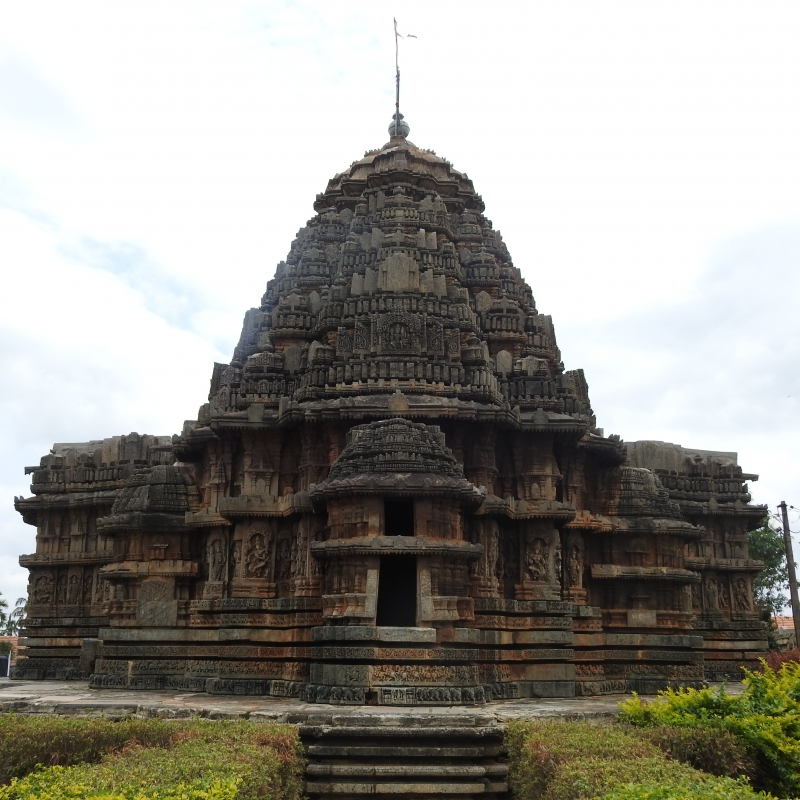 Back view of Lakshmi-Narasimha Temple, Harnahalli, with the main shrine flanked by two sanctums, and an ornate tower and a circumambulatory path (Courtesy: Poorva Salvi)
