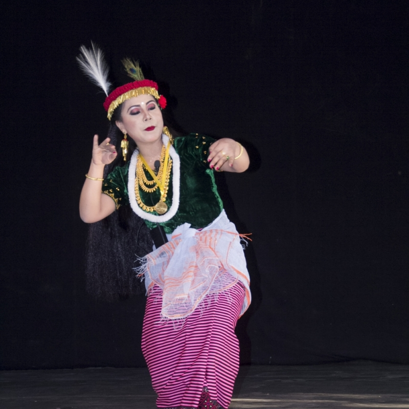 A dancer performs the Khamba Thoibi dance, a thougal jagoi (dance in service of gods) performed during the Lai Haraoba (pleasing of the gods) festival, Manipur. Thoibi's ensemble includes a phanek mayek naibi, a striped phanek with embroidered borders (Courtesy: Jawaharlal Nehru Manipur Dance Academy (JNMDA), Imphal)