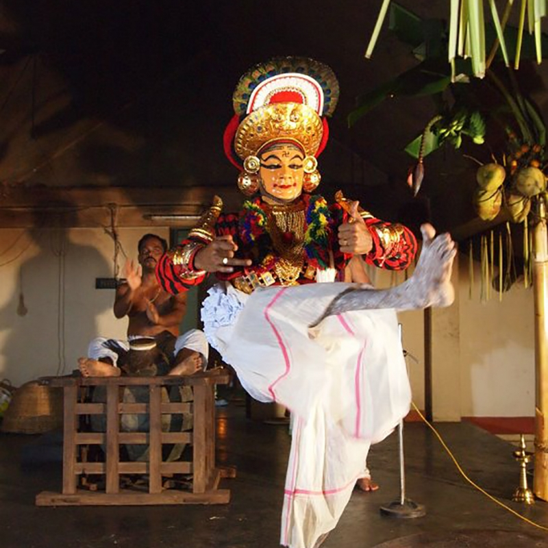 Kutiyattam actor performs while the mizhavu player plays at the back