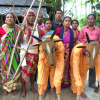 Seen in this picture are the members of the trailblazing women-led khon group, Mohisbathan Narikolyan Samiti, helmed by Akulbala Sarkar, before enactment of the popular drama, Halua Haluani. Presence of props like plough and cow masks add palpability to the tragic representation of a rural household (Courtesy: Shreyosee Sen)