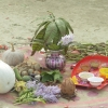 On the night before Gasshi, children form small groups and collect food grains, seasonal vegetables, cooking oil, small bundles of jute, and hyacinth stems and flowers, and arrange them on the courtyard decorated with alpanas. These items are left overnight to soak in the dew, and the vegetables and grains are then cooked into a khichdi in the morning (Courtesy: Md Shalim Muktdir Hussain)