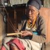 A Ruangmei elder in Rianglong village, Tamenglong, with her nrah (violin/harp). She is 99 years old, which makes her one of the oldest person in her village. Traditionally, women did not learn to play nrah; even though it was not restricted, it was seen as a role not fit for a woman (Courtesy: Guikhiatlu Pamei)