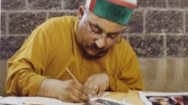 Dr Vijay Sharma, a senior artist at the Bhuri Singh Museum, Chamba, working on a miniature painting (Courtesy: Dr Vijay Sharma)