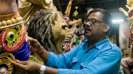 Mintu Pal fixing the costumes on his clay idols prior to delivery (Courtesy: Aaheli Sen)