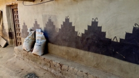 This mural is painted on a wall in the interior courtyard of a Santal house.