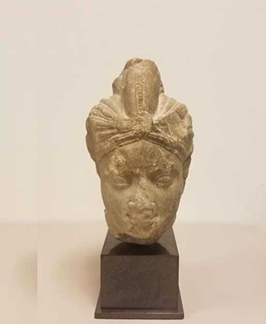 the head of an indian deity, met indian antiques, met statues retured
